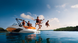 Kids Jumping in Water on Family Boat